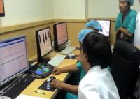 Video quá trình vận hành, bấm nút khởi động quá trình xạ trị của máy