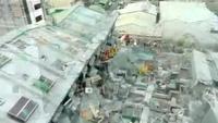 Tòa chung cư cao tầng đổ sập do động đất nhìn từ trên cao