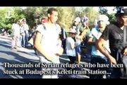Những người dân tị nạn trên hành trình đi bộ hơn 100 dặm để lên tàu nhập cư vào Đức