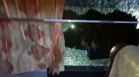 Hình ảnh về chiếc xe bus bị tấn công của ĐT Indonesia
