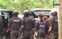 Đoàn Thị Hương mặc áo chống đạn khi rời tòa