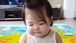 Bé gái mếu máo khi mẹ đút kem ăn